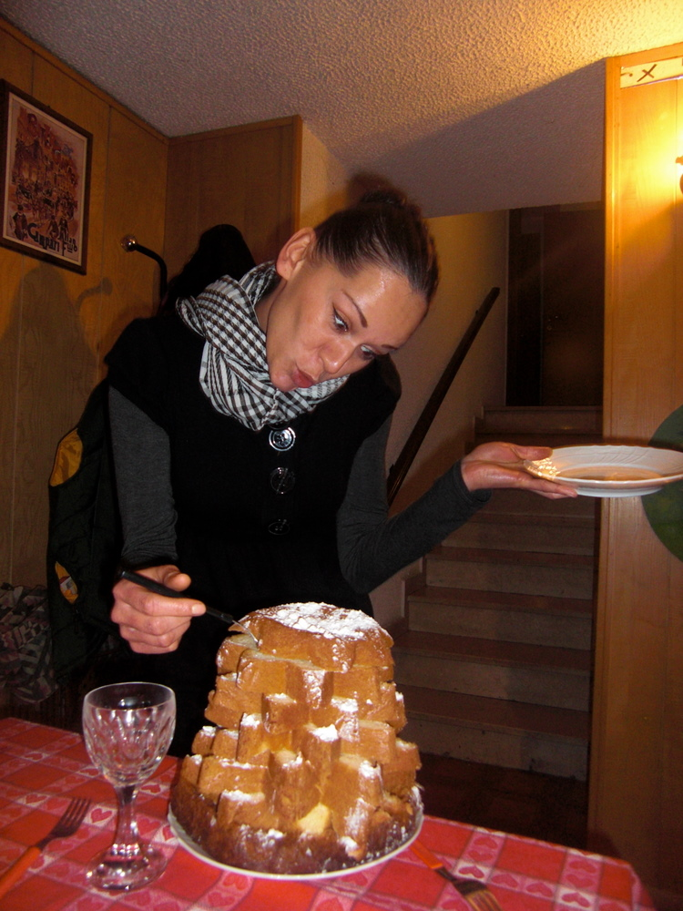 Olga decorating a cake