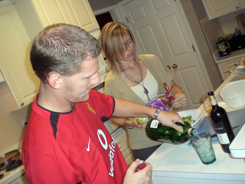 Rob and Dana mixing cocktail with precision