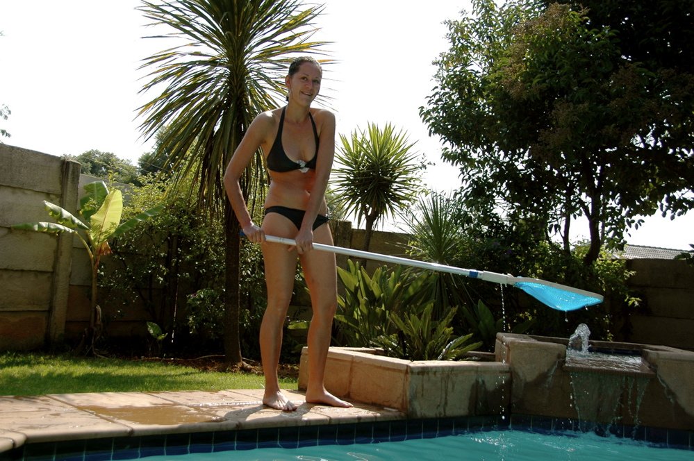 Olga cleaning the pool