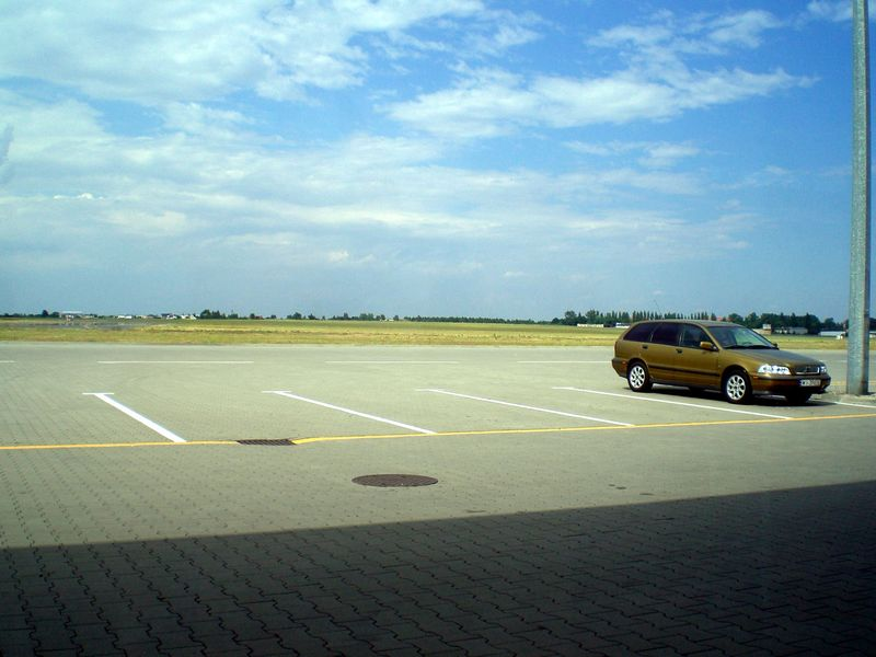 This is the airport. 5 flights every day, and a parked car.
