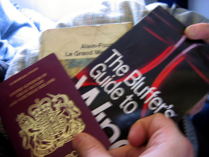 A passport, a book and a guide to wine. Proper tourists